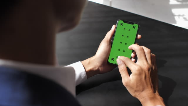 businessman using smart phone with green screen - house key stock videos & royalty-free footage