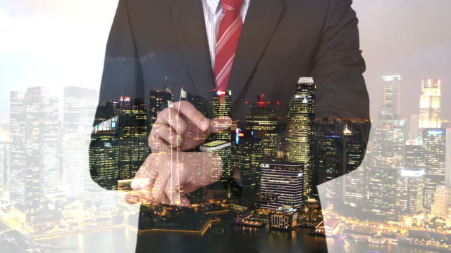 Businessman  using smart watch futuristic concept with city overlay