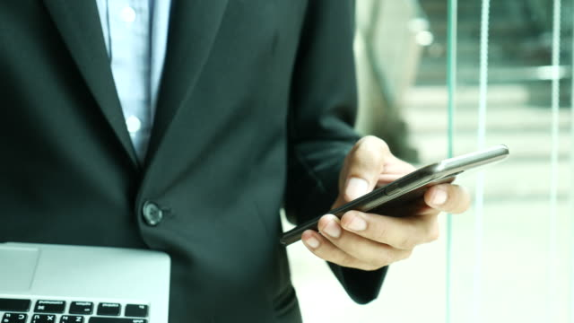 businessman using smartphone for texting - text messaging stock videos & royalty-free footage