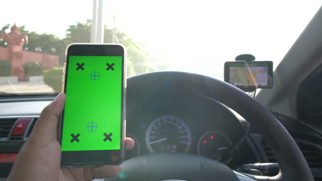 Businessman using Smartphone in car with GPS,Green screen