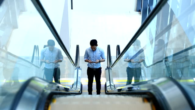 Businessman using Tablet escalator
