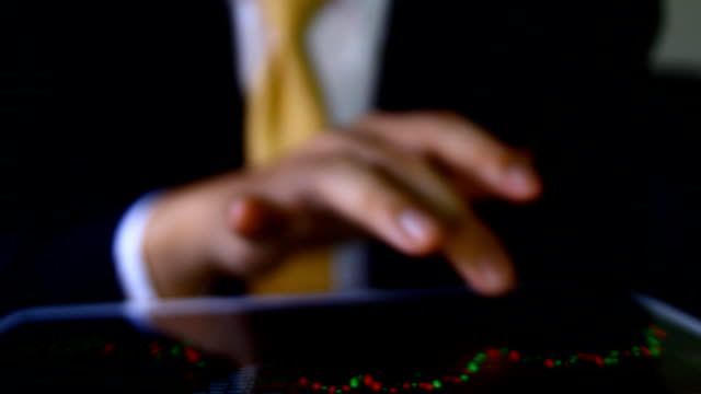 businessman using the tablet with financial graph