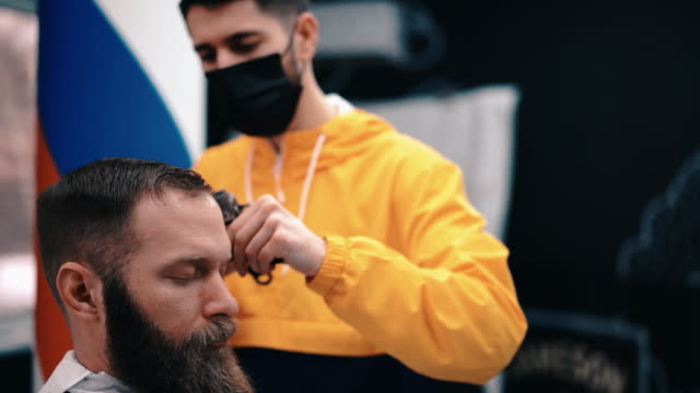 businessman visiting the barber during covid-19 - cutting hair stock videos & royalty-free footage