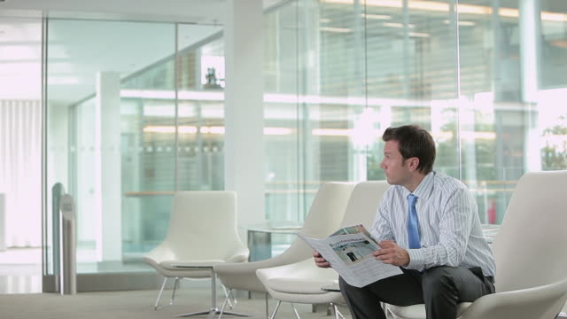 businessman waiting and shaking hands with businesswoman - magazine stock videos & royalty-free footage