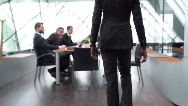 businessman walking into a business meeting - stabilized shot stock videos & royalty-free footage