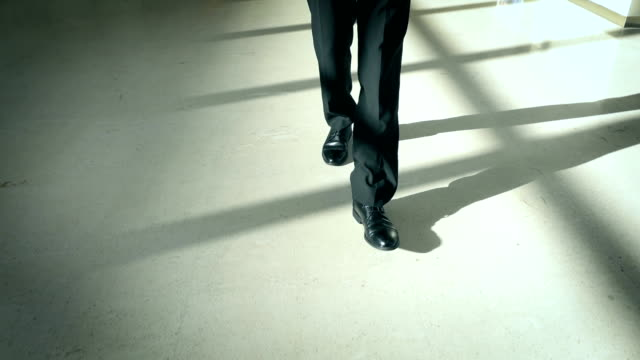 Businessman walking on corridor