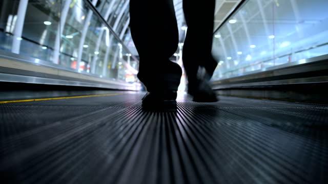 businessman walking on moving walkway - pedestrian walkway stock videos & royalty-free footage