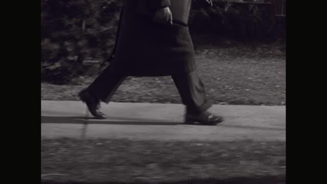 ms ts businessman walking on sidewalk, low section / united states - footwear stock videos & royalty-free footage
