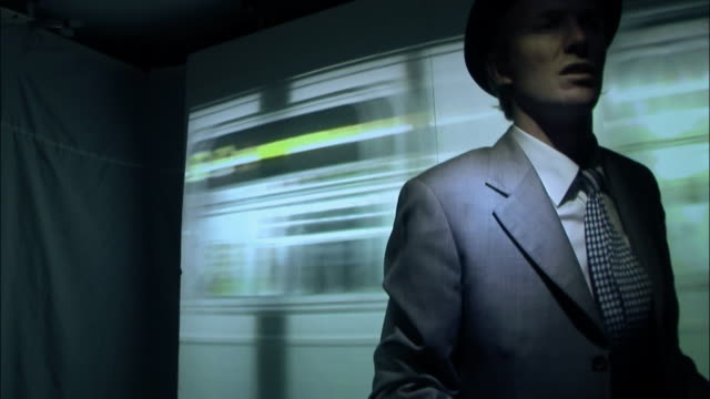 ms businessman walking past subway train reflection in station / new york city, new york, usa - film noir style stock videos & royalty-free footage