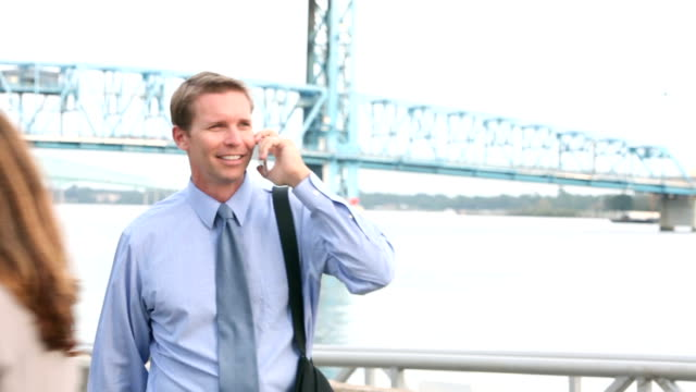 businessman walking, talking on mobile phone - shirt and tie stock videos & royalty-free footage