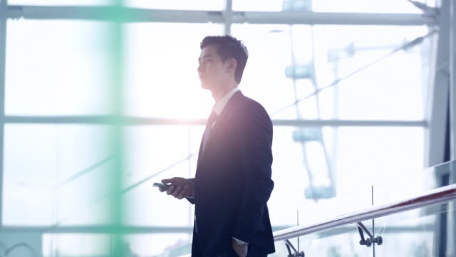 MS Businessman walking through a modern office building.