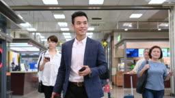 Businessman walking through airport terminal