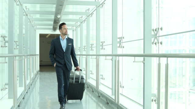 Businessman walking through airport terminal
