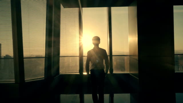 businessman walking to sunlight - businessman stock videos & royalty-free footage