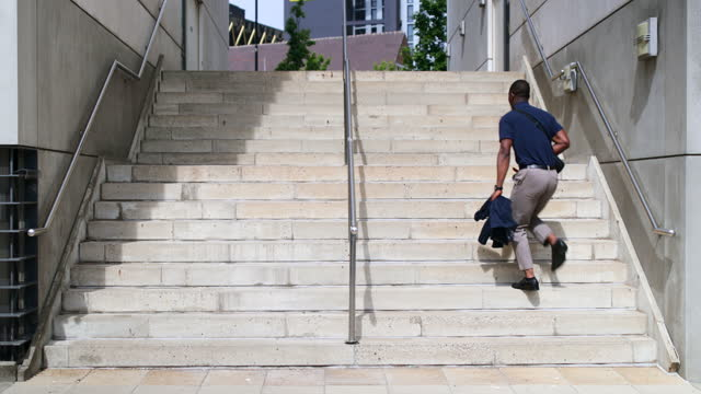 businessman walking up stairs in the city - formal businesswear stock videos & royalty-free footage