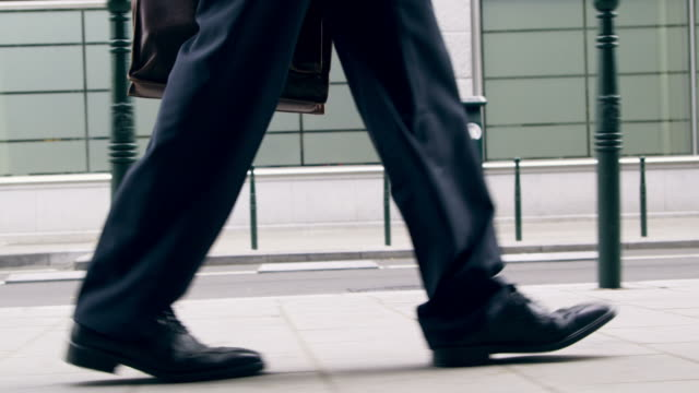 businessman walking - human leg stock videos & royalty-free footage