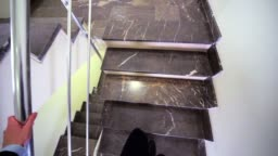 businessman walks up stairs to landing view from headcam
