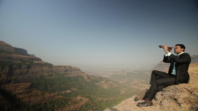 businessman watching mountains through day telescope  - binoculars stock videos & royalty-free footage