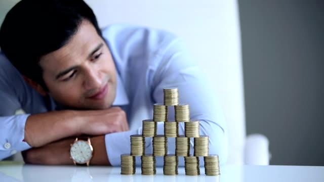 businessman watching stacking coins, delhi, india - hemd und krawatte stock-videos und b-roll-filmmaterial