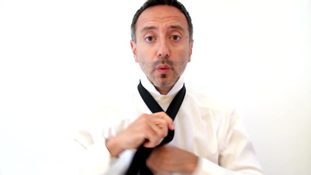 businessman whistling while puts on a necktie - tied up stock videos & royalty-free footage