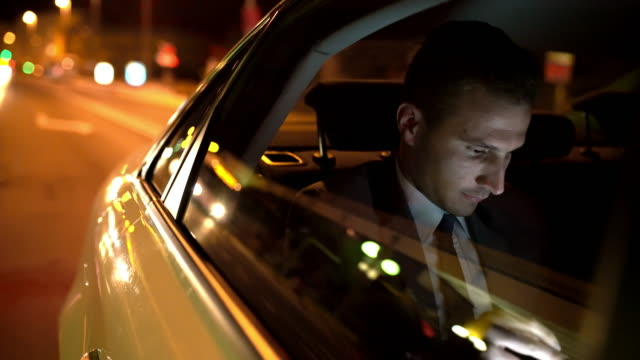 ms businessman wind down a window of a car to take a fresh air - business travel stock videos & royalty-free footage