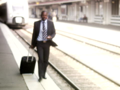 a businessman with a bag at a train station stockholm sweden. - one mid adult man only stock videos & royalty-free footage
