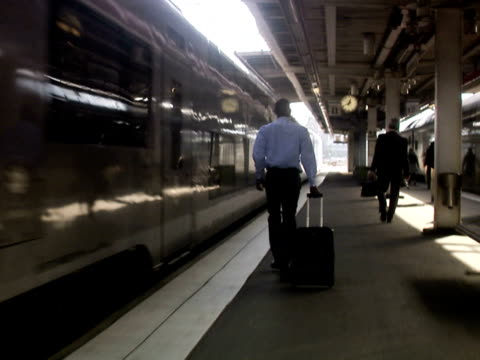 a businessman with a bag at a train station stockholm sweden. - only mid adult men stock videos & royalty-free footage