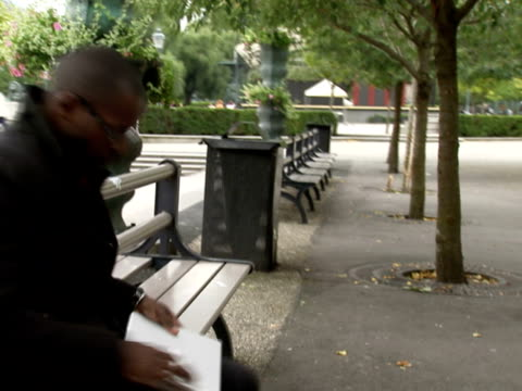 a businessman with a laptop in a park stockholm sweden. - only mid adult men stock videos & royalty-free footage