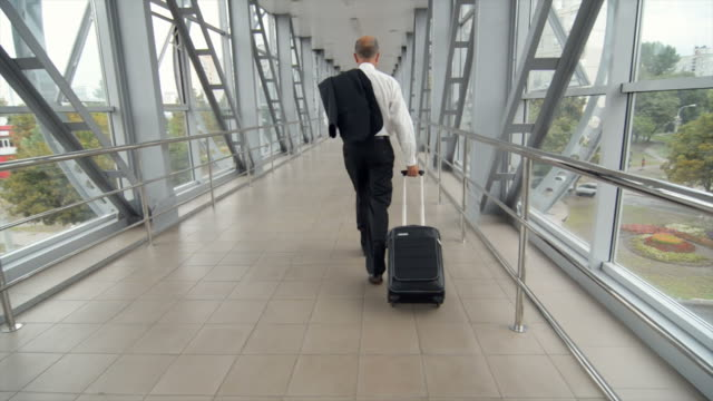 businessman with bag in transit station overpass