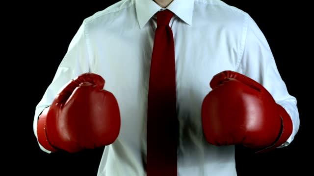 hd スローモーション: ビジネスマン、ボクシンググローブ - ボクシンググローブ点の映像素材/bロール