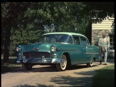 1955 businessman with briefcase gets into blue chevrolet bel air in driveway - chevrolet stock videos & royalty-free footage