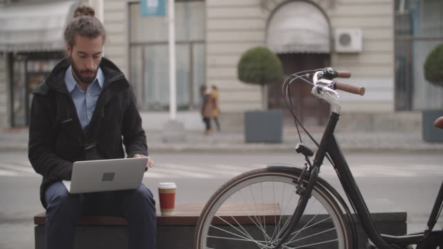 businessman with bun commuting with bicycle. - disposable cup stock videos and b-roll footage