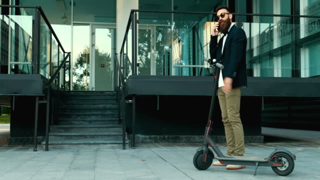 businessman with electric push scooter - scooter stock videos & royalty-free footage