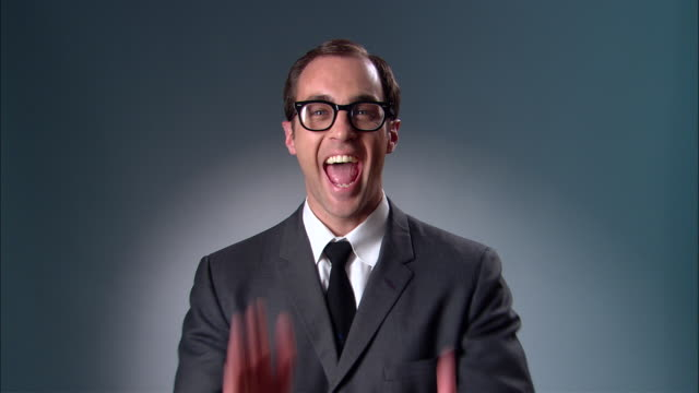 cu businessman with glasses smiling and clapping enthusiastically/ new york city - one mid adult man only stock videos & royalty-free footage