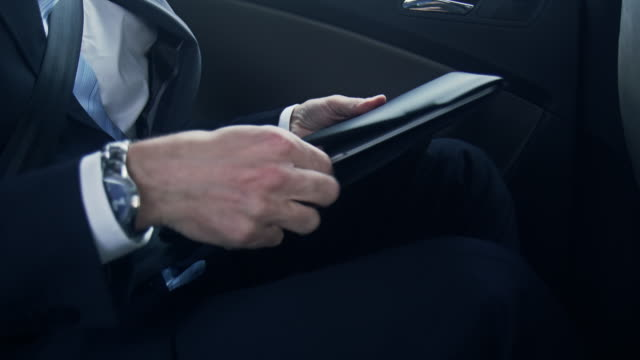 businessman with laptop in car - chauffeur stock videos and b-roll footage