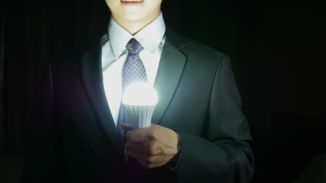 Businessman with Light bulbs glowing