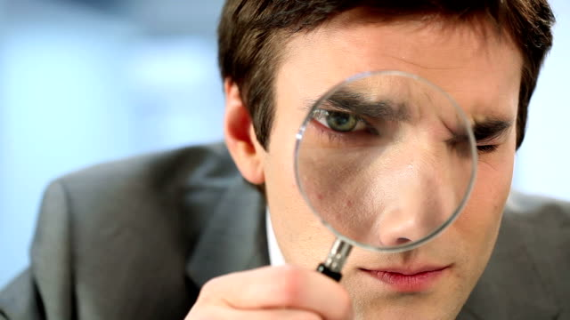 businessman with magnifying glass - detective stock videos & royalty-free footage