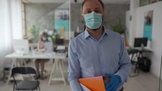 businessman with protective face mask in office - challenge stock videos & royalty-free footage