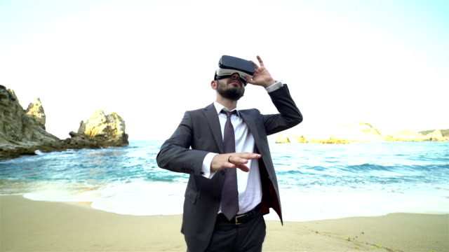 businessman with virtual reality user on the beach - distillery still stock videos and b-roll footage