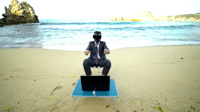 Businessman with Virtual Reality User on the Beach