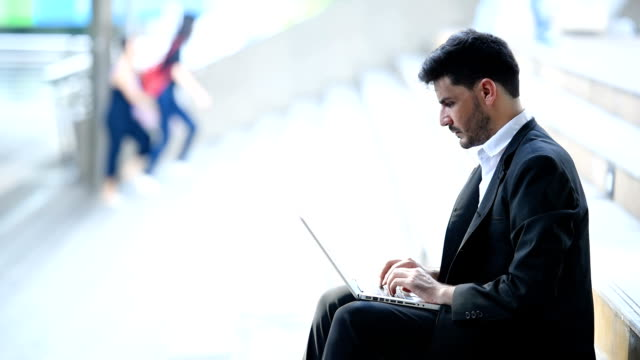 businessman work outdoor with laptop in area public