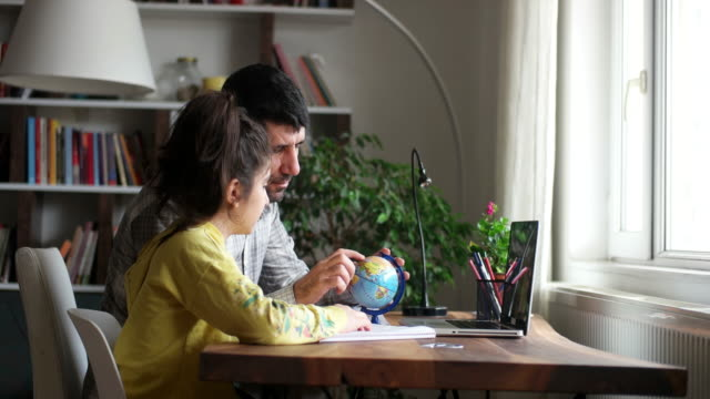 businessman working at home with child. child is making homework. - showing stock videos & royalty-free footage