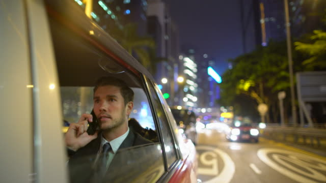 ms ts businessman working in a car at night, hong kong - taxi stock videos & royalty-free footage