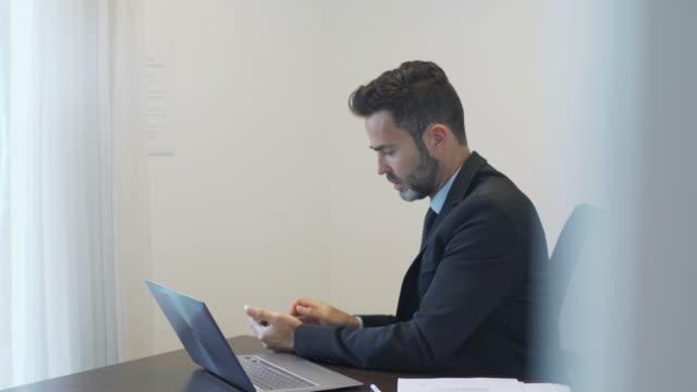 businessman working in office - landline phone video stock e b–roll