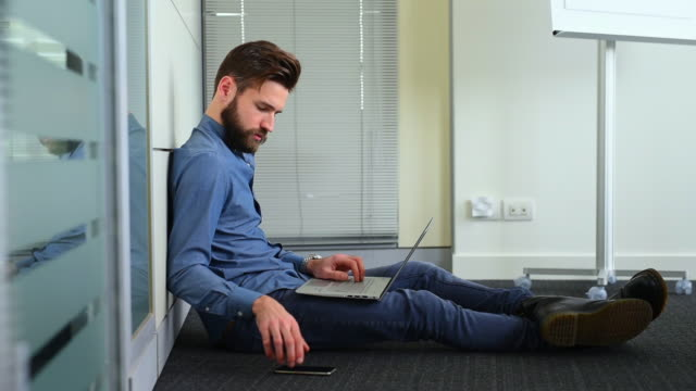 businessman working in office - sitting on ground stock videos & royalty-free footage