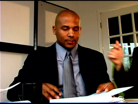 businessman working in office - one mid adult man only stock videos & royalty-free footage