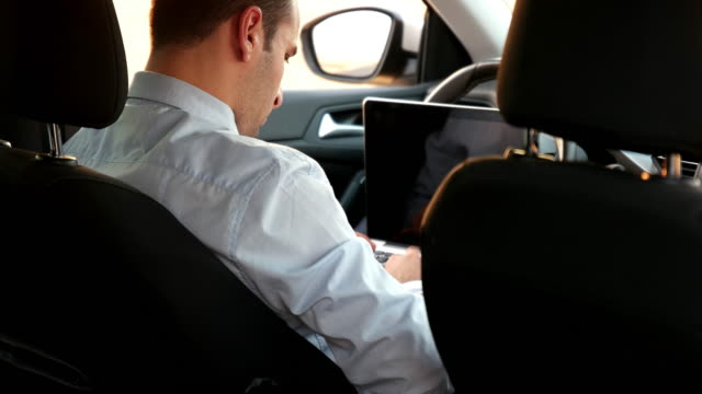 businessman working in the drivers seat - white collar worker stock videos and b-roll footage