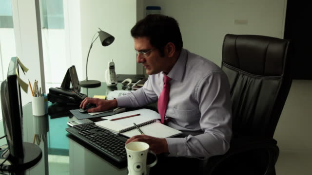 Businessman working on a desktop in an office