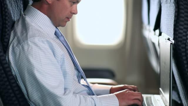 Businessman working on aeroplane
