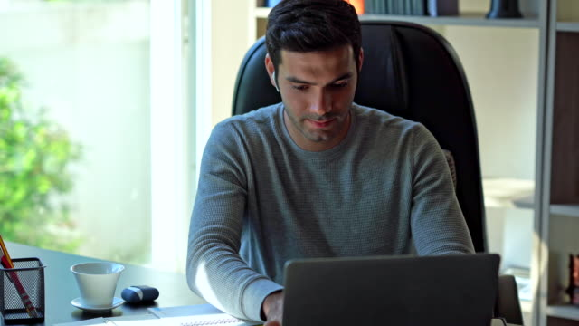 businessman working on desk at home - one young man only stock videos & royalty-free footage